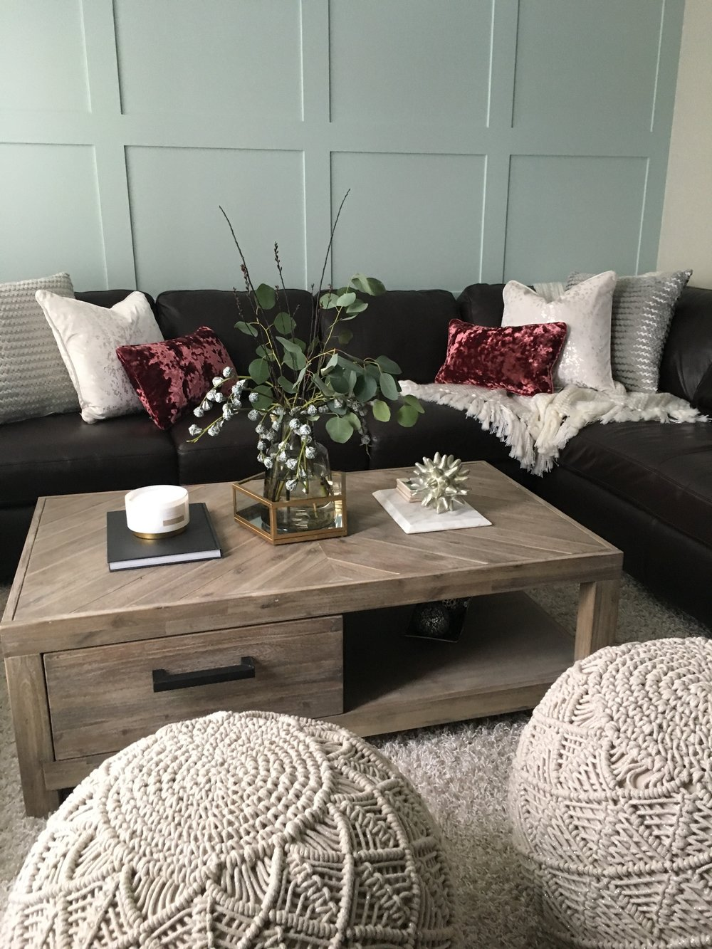 [SOFA: EXISTING, POUFS: HOMESENSE, COFFEE TABLE: URBAN BARN, ACCESSORIES: HOMESENSE, RUG: EXISTING]