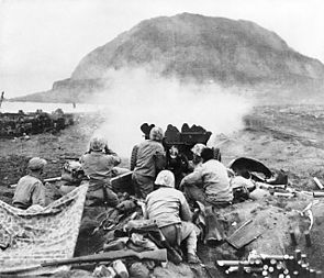 37mm_Gun_fires_against_cave_positions_at_Iwo_Jima.jpg