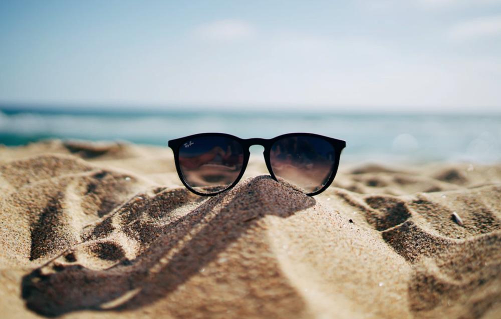 RayBan sunglasses on sand.png