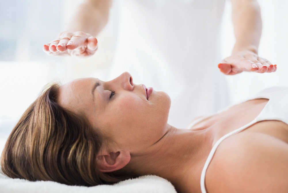 woman recieving reiki in spa 2018-08-20 11-29-28.jpg