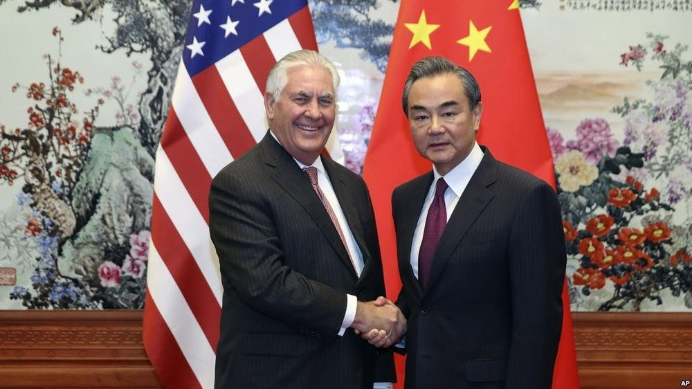 Credit : U.S. Secretary of State Rex Tillerson, left, shakes hands with Chinese Foreign Minister Wang Yi before their meeting at the Great Hall of the People in Beijing, Sept. 30, 2017 (AP)