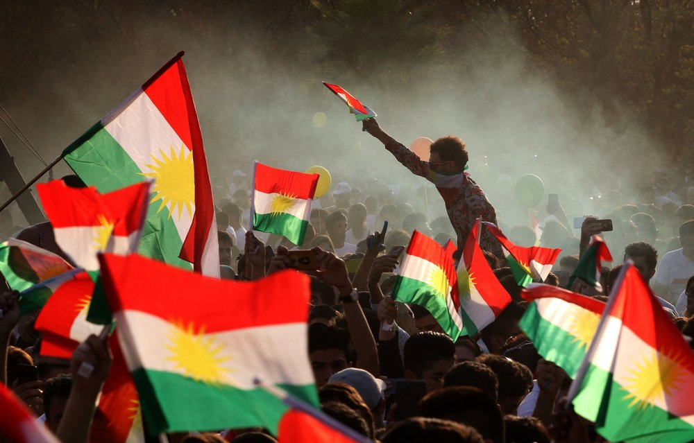 Photo: Flags waving as a Kurdish nationalist euphoria has swept Iraqi Kurdistan ahead of a referendum. Photo Courtesy: NY Times, Safin Hamed/Agence France-Presse — Getty Images