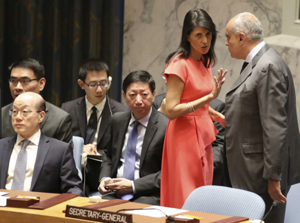 Photo: U.S. Ambassador to the United Nations Nikki Haley, left, speaks to Egyptian Ambassador and current Security Council President Amr Abdellatif Aboulatta before a Security Council vote on a new sanctions resolution that would increase economic pressure on North Korea to return to negotiations on its missile program, Saturday, Aug. 5, 2017 at U.N. headquarters.  Photo Courtesy: AP/Mary Altaffer