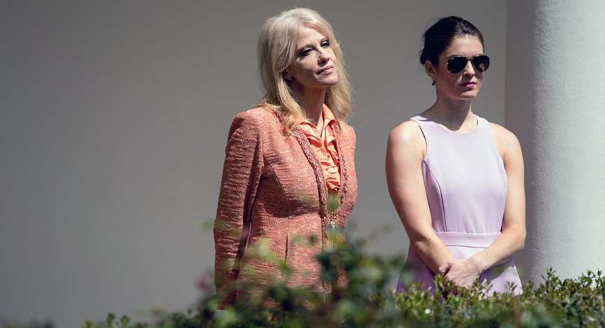 Counselor to the president Kellyanne Conway (left) and White House communications director Hope Hicks stand by the Rose Garden at the White House on April 5. | Andrew Harnik/AP