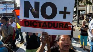 Photo: Anti-government protesters in Venezuela accusing President Maduro of moving towards a dictatorship  Photo Courtesy: AFP
