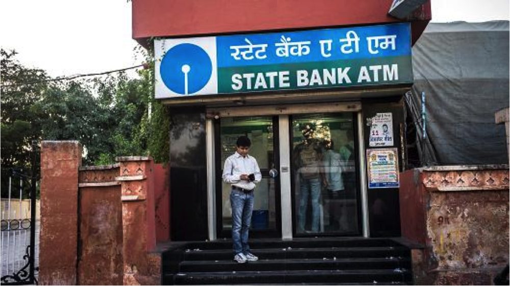 Customer in front of an Indian state bank ATM (Credit: Bloomberg)
