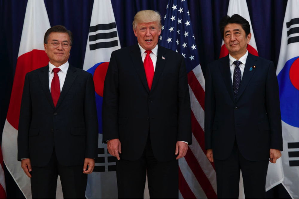 President Trump with Japanese Prime Minister Shinzo Abe, right, and South Korean president Moon Jae-in. (Evan Vucci/AP)