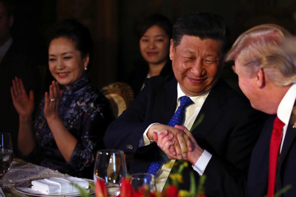 President Trump and President Xi Jinping (CARLOS BARRIA/REUTERS)