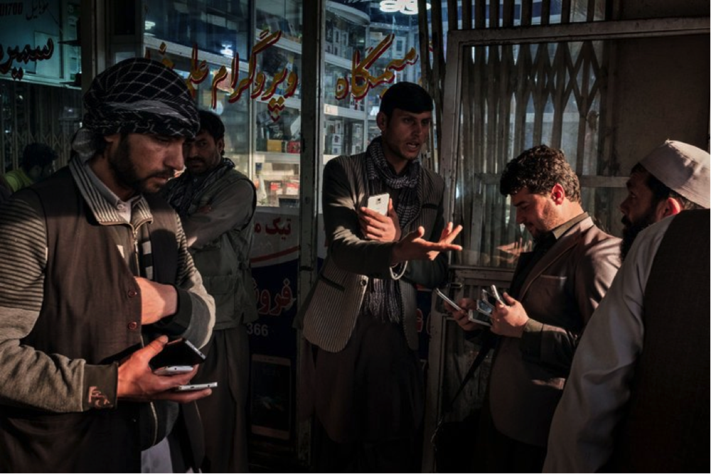 Afghans selling phones last year at a market in Kabul, the capital (Credit:  The New York Times)