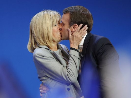 French centrist presidential candidate Emmanuel Macron kisses his wife Brigitte before addressing his supporters at his election day headquarters in Paris on Sunday.  (Credit : Christophe Ena, AP)