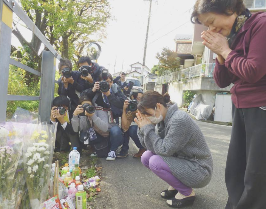 Photograph showing Shirahishi's victim's relatives mourning  Credit: Japan Times