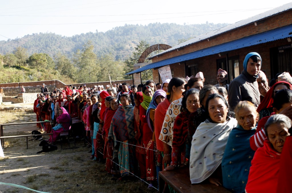 ( Voters lining up in Nepal's Kabhrepalanchok district in the first round of elections in May ; Credit: The Wire, May 7th, 2017).