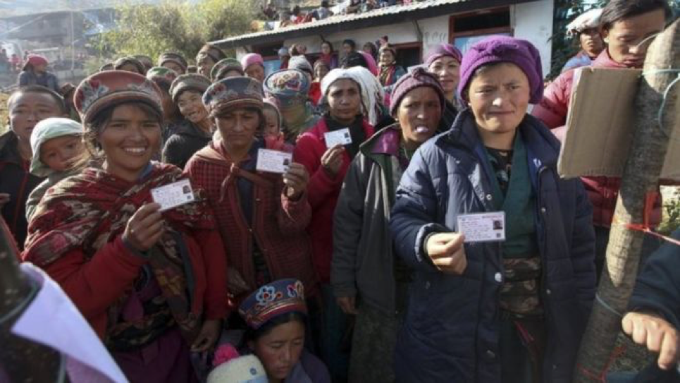 ( Eligible voters flash their IDs as they brave cold weather to vote in Nepal's first general election since its civil war ; Credit: BBC News, November 26th, 2017).