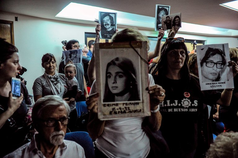Relatives of those who disappeared listen to the sentencing hearing in Buenos Aires on Wednesday (New York Times)