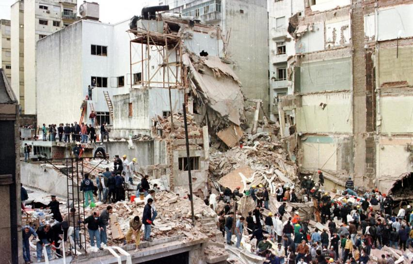 Rescue workers search for survivors and victims in the rubble after a powerful car bomb destroyed the Buenos Aires headquarters of the Argentine Israelite Mutual Association (AMIA), on July 18, 1994 (Reuters)