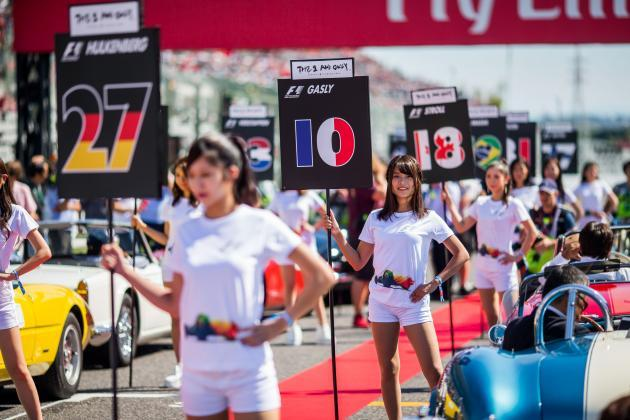 """Grid girls"" holding driver name boards during a Formula One race.(Photo Credit: TalkSport)"