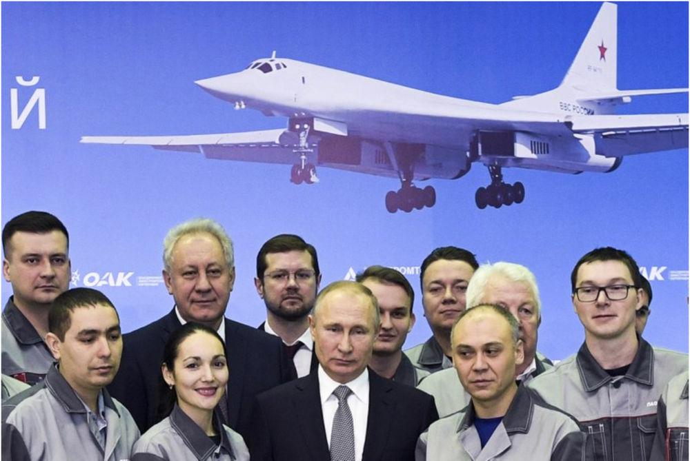 [Russian President Vladimir Putin (center) poses with employees of an aircraft-manufacturing plant during a visit to Kazan, Russia on Jan. 25, 2018. Photo: Alexei Nikolsky, Sputnik, Kremlin Pool Photo via AP]