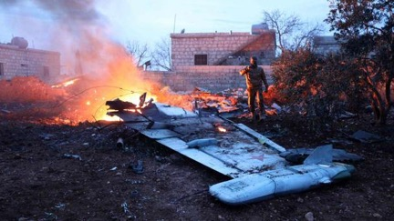 Burning remains of downed Russian fighter jet | Omar Haj Kadour/AFP