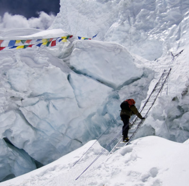 (a mountaineer uses ladder cross over a dangerous crevasse, Source:  https://adventure.howstuffworks.com/mount-everest-pictures.htm )