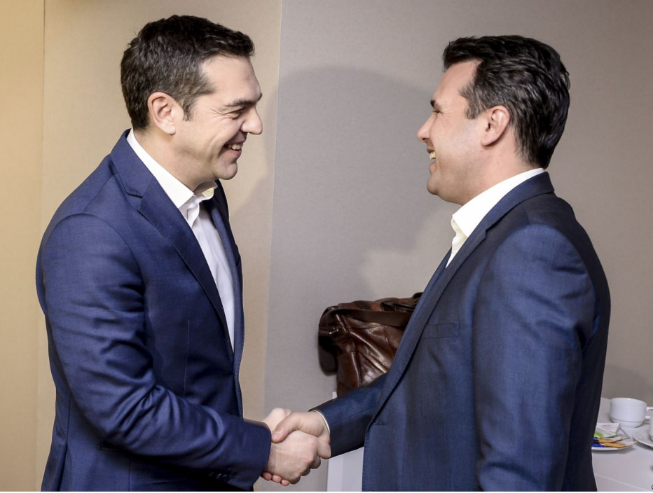 [Greek Prime Minister Alexis Tsipras (left) shakes hands with Macedonian Prime Minister Zoran Zaev at the sidelines of the World Economic Forum in Davos on Jan. 24, 2018. Photo: RFE/RL]