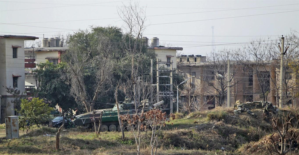 (Indian army tank moves around Indian army base situated in Jammu, within the Indian controlled Kashmir region, where they expect militants to be held up; Credit: 680News, February 11th, 2018.  http://www.680news.com/2018/02/11/6-dead-in-militant-attack-on-indian-army-base-in-kashmir/ ).