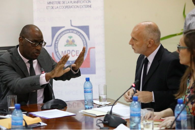 Aviol Fleurant, Haiti's minister of planning and external cooperation, left, meeting on Thursday with the Oxfam officials Simon Ticehurst and Margalida Massot (New York Times)