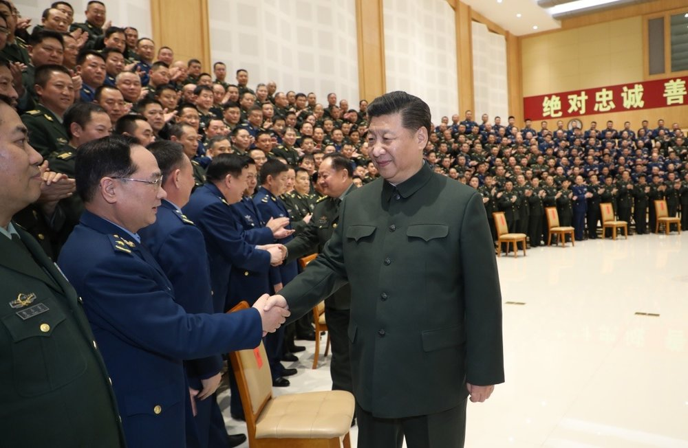 Xi greeting the Chinese military (Source:  Xinhua news )