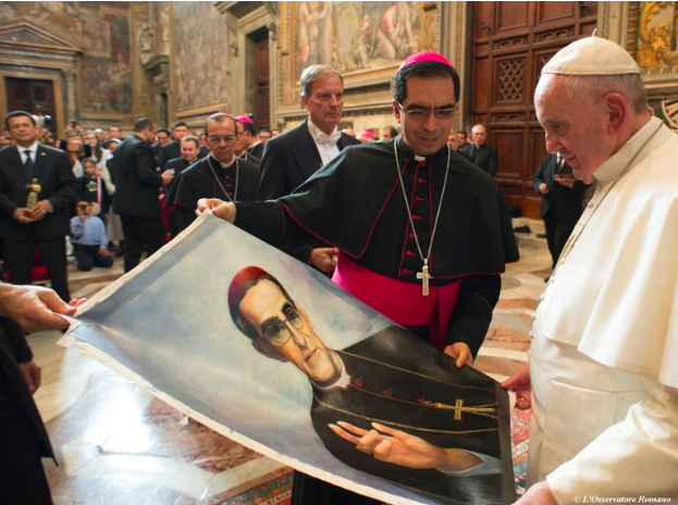 Pope Francis is presented with an image of Archbishop Óscar Romero in 2015 (New York Times)