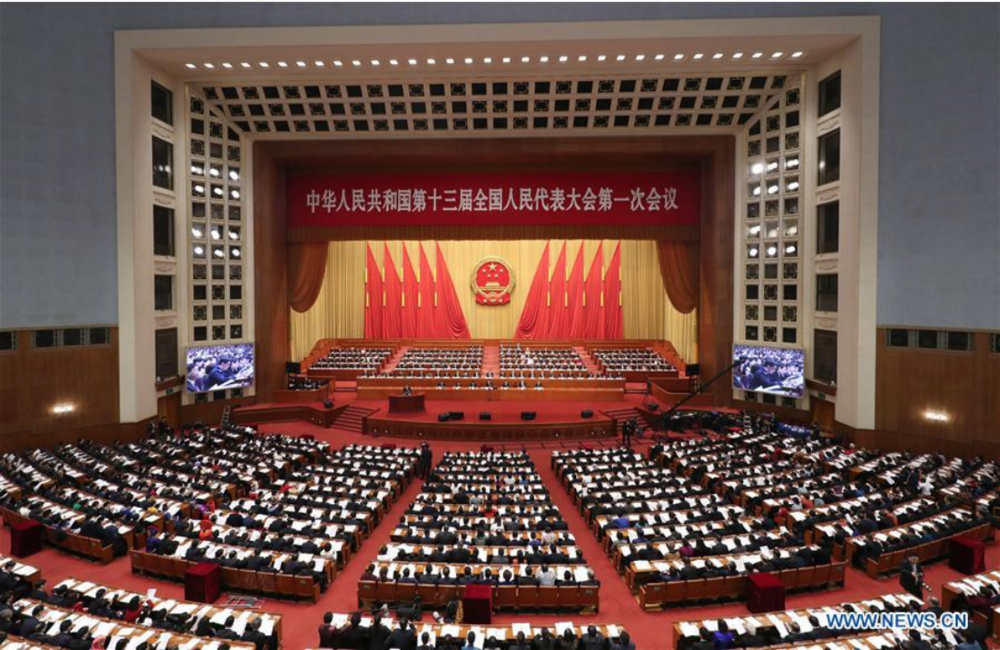 [The first session of the full 13th National People's Congress assembled in the Great Hall of the People in Beijing on Mar. 9, 2018. Photo: Xinhua/Ding Haitao]