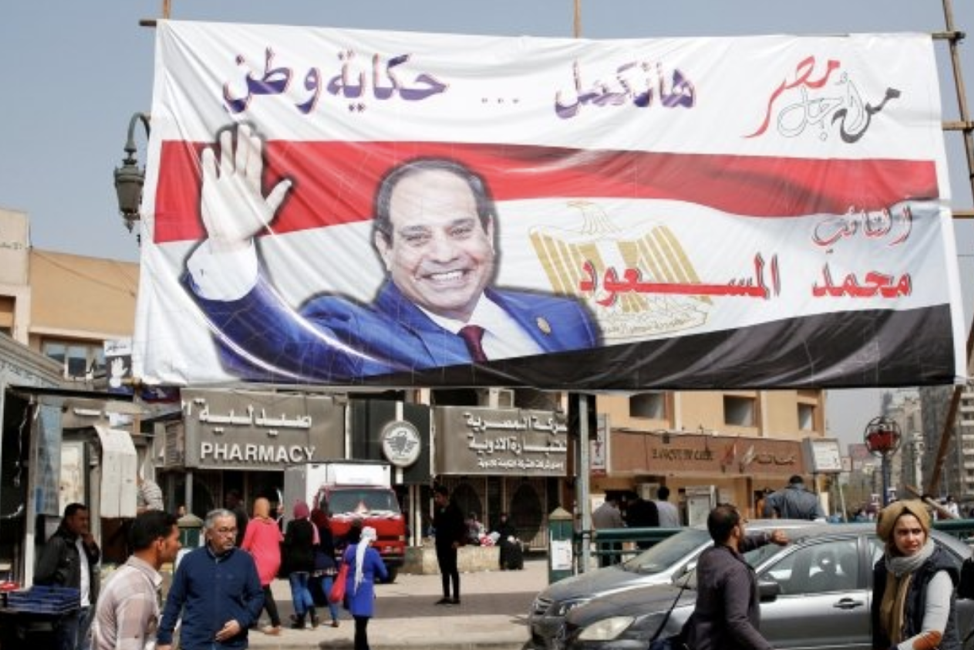 A poster of Egyptian President Abdel Fattah al-Sisi, the only viable contender in the 2018 presidential election because of media suppression and intimidation of potential opposition. (Source:  http://timesofoman.com/article/130255 )