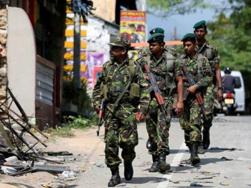 ( Sri Lankan Special Task Force soldiers patrolling the central Kandy district of Sri Lanka ; Credit: The Express Tribune, March 18th, 2018).