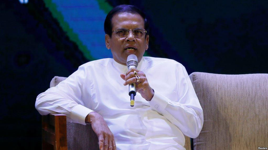 "( Sri Lankan President Maithripala Sirisena speaking during the ""Vision 2025"" launching ceremony in Colombo, Sri Lanka ; Credit: VOA News, March 18th, 2018)."