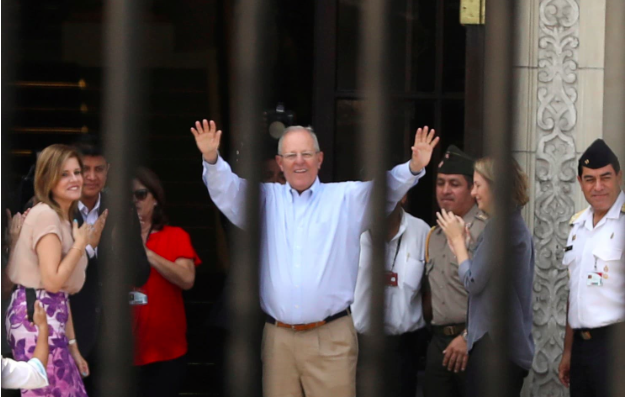 Peru's outgoing president, Pedro Pablo Kuczynski, greets palace staff members after his resignation, at the Government Palace in Lima on March 22 (Washington Post)