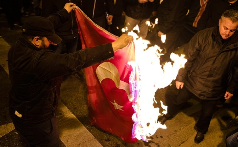 March 5th- protesters burn Turkey's flag.   Source: Daily Sabah