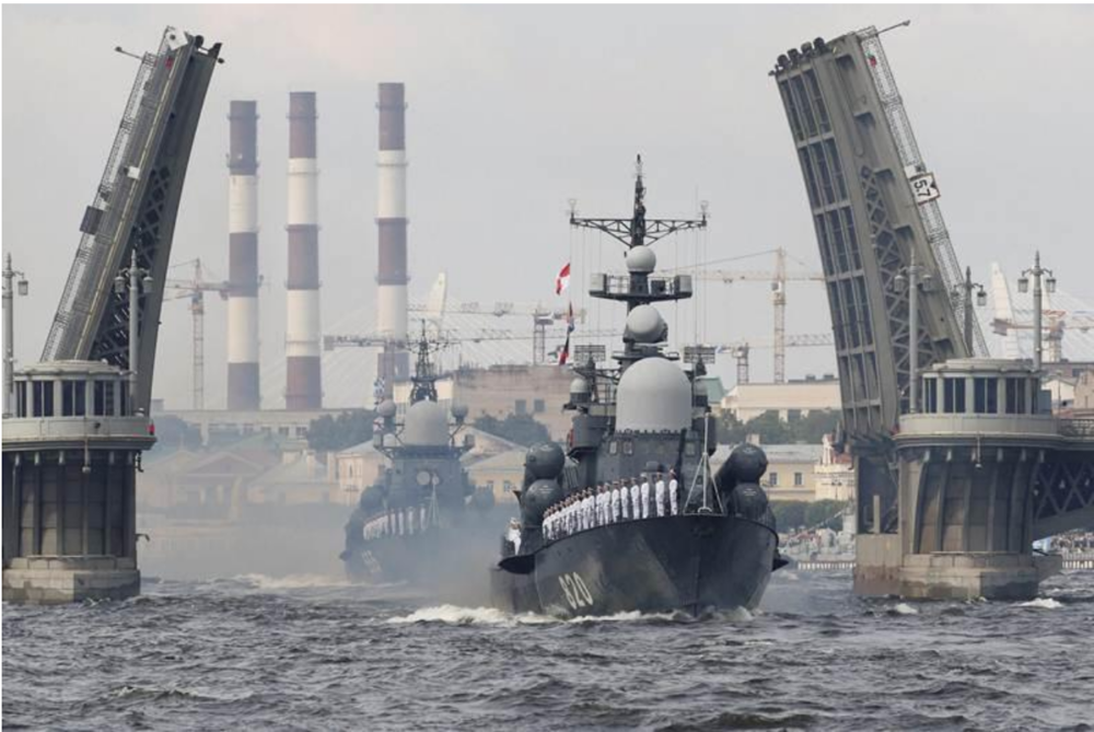 [Russian Navy ships sail on the Neva River during the naval parade for the 2017 Navy Day celebrations in St. Petersburg, Russia. Photo: AP]