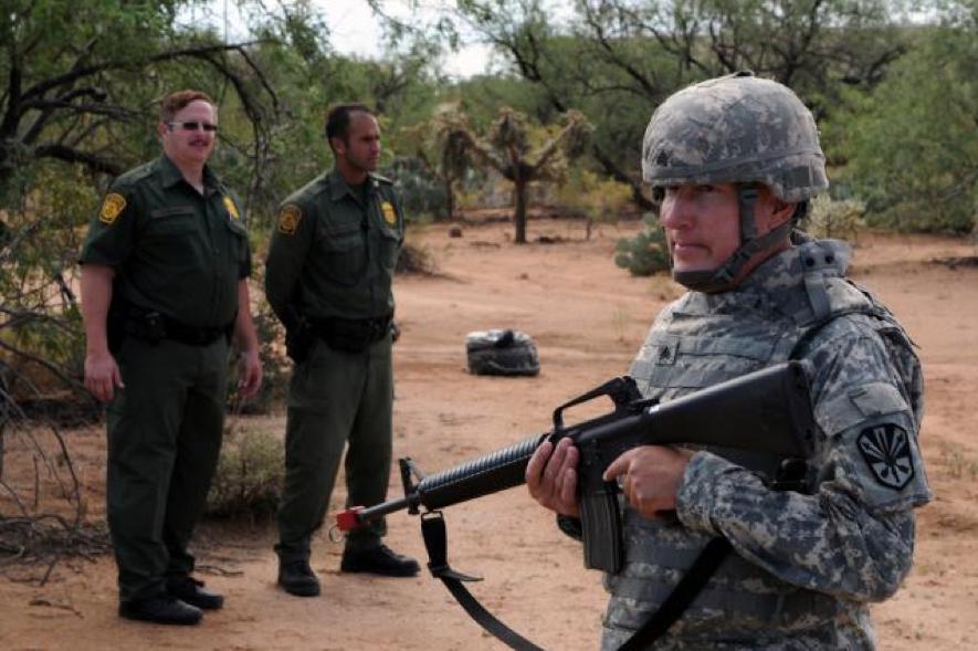 Border Patrol Agents Observing Arizona National Guardsman. (Staff Sgt. Jim Greenhill/U.S. Army).