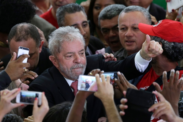 Photo: Luiz Inacio Lula da Silva flashes a thumbs up at his supporters back in 2016. Source: CTV News
