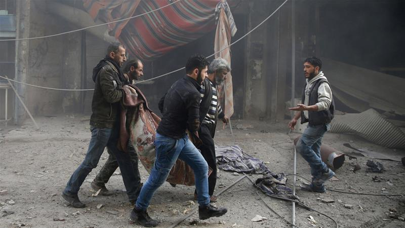 Civilians carrying a body in Eastern Ghouta | Bassam Khabieh/Reuters