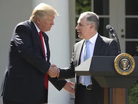 President Trump shakes hands with Scott Pruitt after the U.S. Resignation from the Paris Climate Accords last year. (Source: Andrew Harnik/AP)