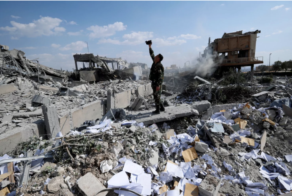 Syrian Soldier Surveys the Damage of the Syrian Scientific Research Center in Barzeh, Syria (Hassan Ammar, AP Photo)