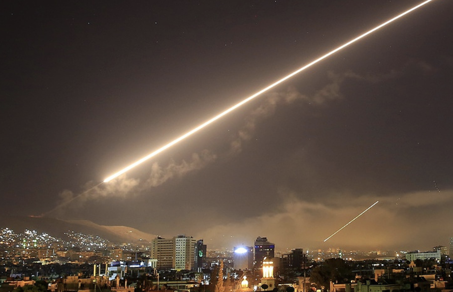 Syrian Missile Defense Systems Firing Outside of Damascus (AP Photo/Hassan Ammar)