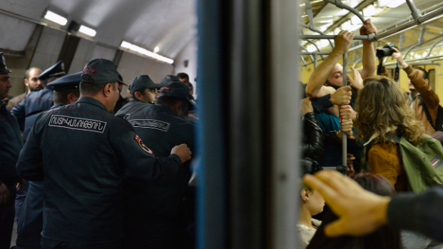Opposition demonstrators block the doorway of an underground train during a protest on Apr. 16, 2018, against former President Serzh Sarksyan's appointment as Prime Minister of Armenia (Karo Sahakyan/AP)