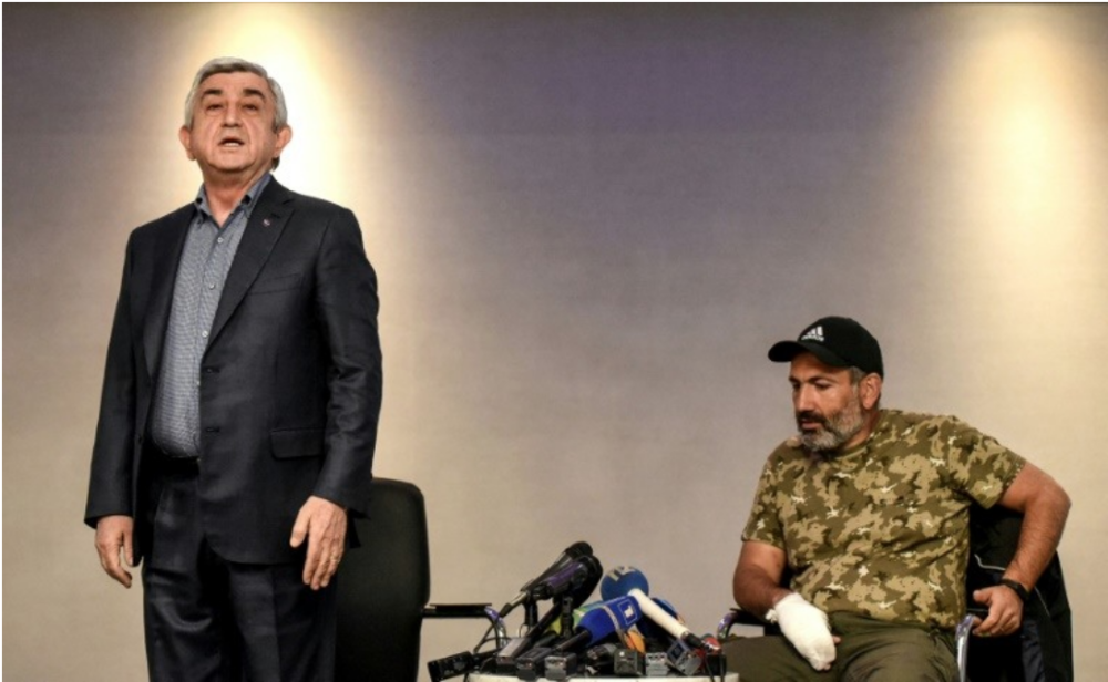 [Embattled then-Prime Minister of Armenia Serzh Sarkysan (left) storms out of tense televised talks with opposition leader Nikol Pashinyan on Sunday, Apr. 22, 2018. Photo: AFP/File / Vano Shlamov]