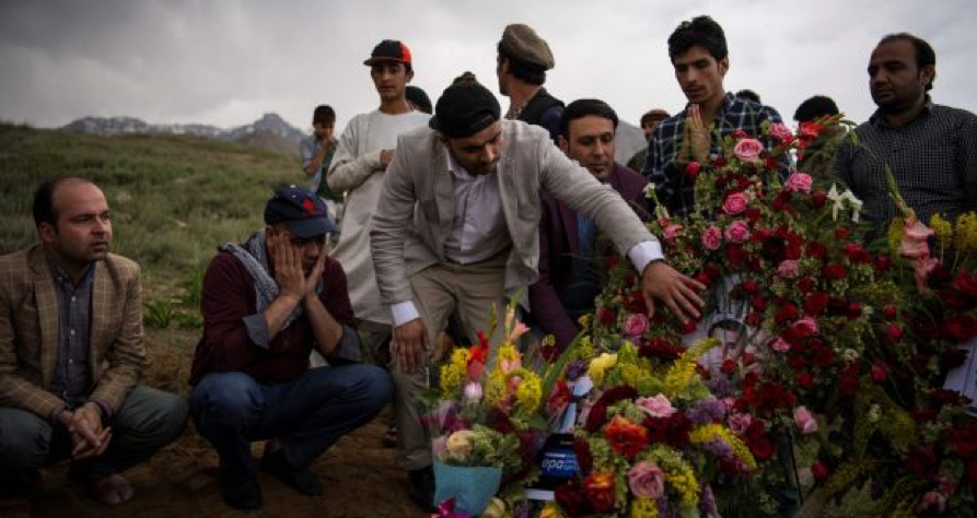 ( Friends and family of Shah Marai, Agence-France Presse Chief Photographer, gather at his burial site on April 30th, 2018 in Gul Dara, Kabul ; Credit: Irish Times, Andrew Quilty, AFP, Getty Images; April 30th, 2018).