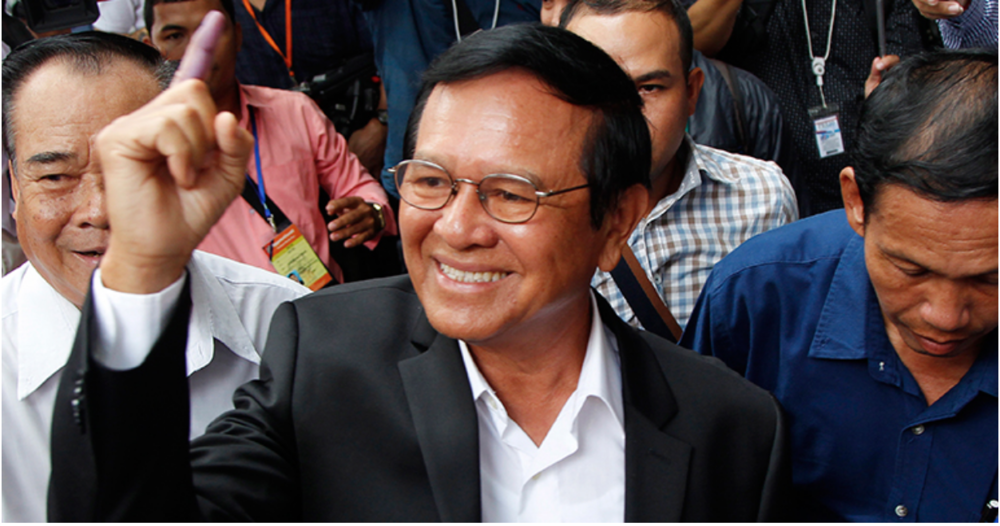Cambodian opposition leader Kem Sokha showing his inked finger after voting in the local council elections in 2017 (Source: Southeast Asia Globe)