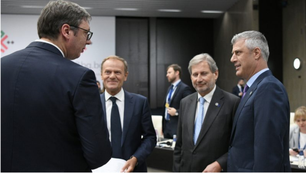 President of Serbia Aleksandar Vučić (front left) talks to President of Kosovo Hashim Thaçi (front right) as President of the European Council Donald Tusk (back left) and European Commissioner for European Neighborhood Policy and Enlargement Negotiations Johannes Hahn (back right) look on at an informal European Union roundtable with Western Balkan countries held in Sofia, Bulgaria on May 17, 2018. Photo:  DIMITAR DILKOFF/EPA/EFE