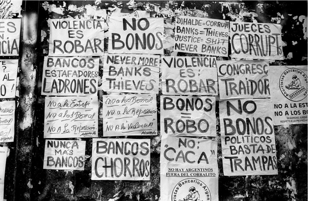 "Signs translating to ""no more banks,"" ""no bonds,"" and ""defrauding, stealing banks"" on the wall of Banco de Boston in Buenos Aires. (Source: Citco.fr)"