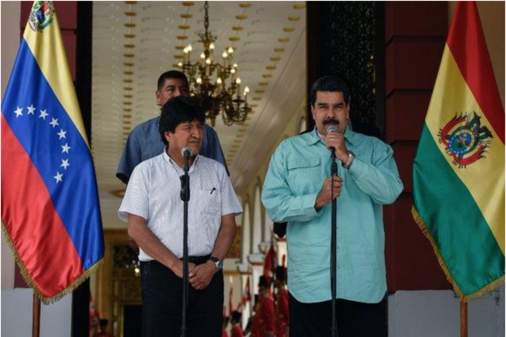 Photo: Current Venezuelan President Nicolás Maduro with closest ally in President Evo Morales of Bolivia  Source: Federico Parra/Agence France-Presse — Getty Images