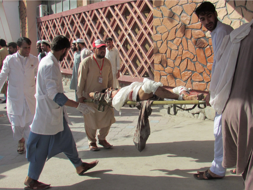 Rescue workers aiding civilians wounded in the suicide bombing in the Nangarhar province  Credit:  New York Times