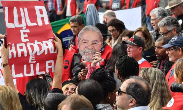 [The Worker Party emphasizes Lula and Haddad as one in the same. Source:  theGuardian ]